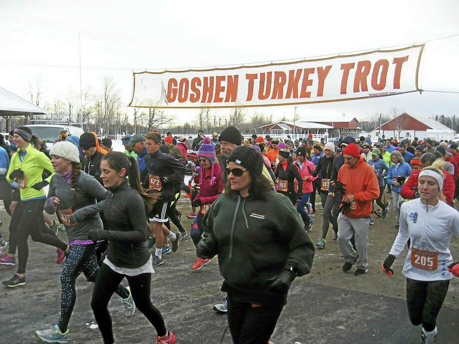 Runners and spectators gather at Goshen Fairgrounds for the annual Turkey Trot. Photo: Photos By John Torsiello