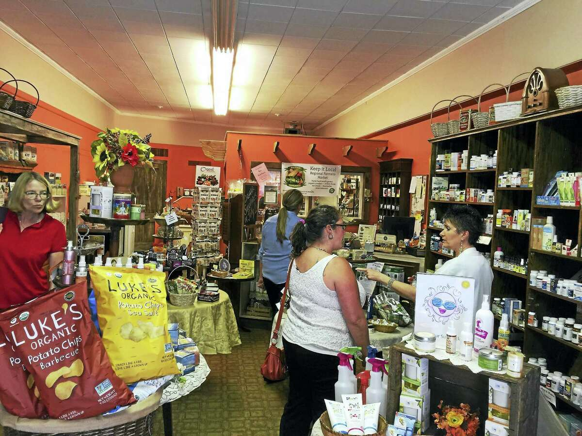 Ben Lambert - The Register Citizen Customers chat during their visit to Act Natural Health and Wellness, located at 24 Water Street in Torrington.