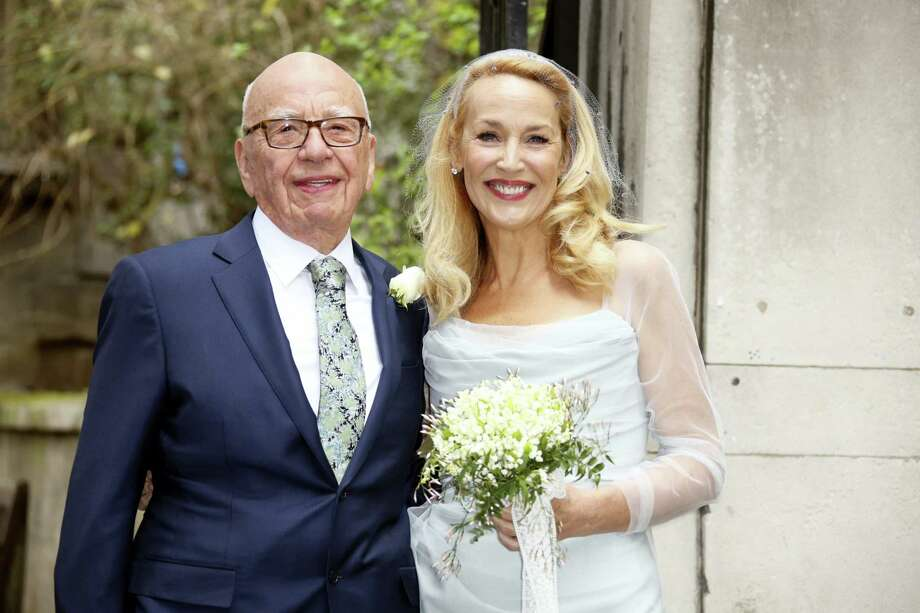 Rupert Murdoch, left, and Jerry Hall leave St Bride's Church after the celebration ceremony of the wedding of Rupert Murdoch and Jerry Hall in London, Saturday, March 5, 2016. Photo: Photo By Joel Ryan/Invision/AP   / Invision