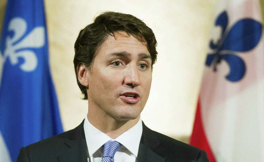"In this Jan. 26, 2016 file photo, Canadian Prime Minister Justin Trudeau speaks during a news conference in Montreal, following his meeting with Montreal mayor Denis Coderre. Trudeau says Canadians would appreciate it if Americans paid more attention to what's going on around the globe. Trudeau said in a 60 Minutes interview to be aired Sunday, March 6, 2016, that ""it might be nice if they paid a little more attention to the world."" Photo: Graham Hughes/The Canadian Press Via AP, File   / The Canadian Press"