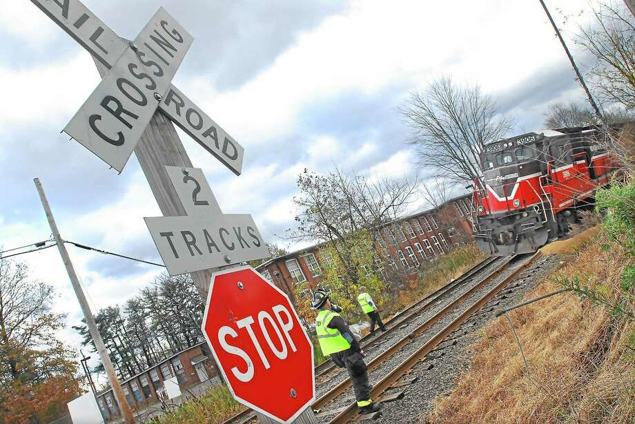 Railways across the country might have to suspend operations in January should they fail to meet an end-of-year congressional deadline for installing safety technology. Photo: Middletown Press File Photo