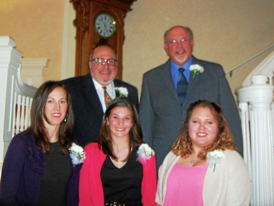 Torrington High School inducted its 19th Athletic Hall of Fame class Sunday evening. The new members are, front row, left to right: Erika Fritch Pratt; Daniela Ponte; Ali Bronson. Back row, left to right: Ed Arum; Joe Lefkowski. Photo: Peter Walace — Register Citizen