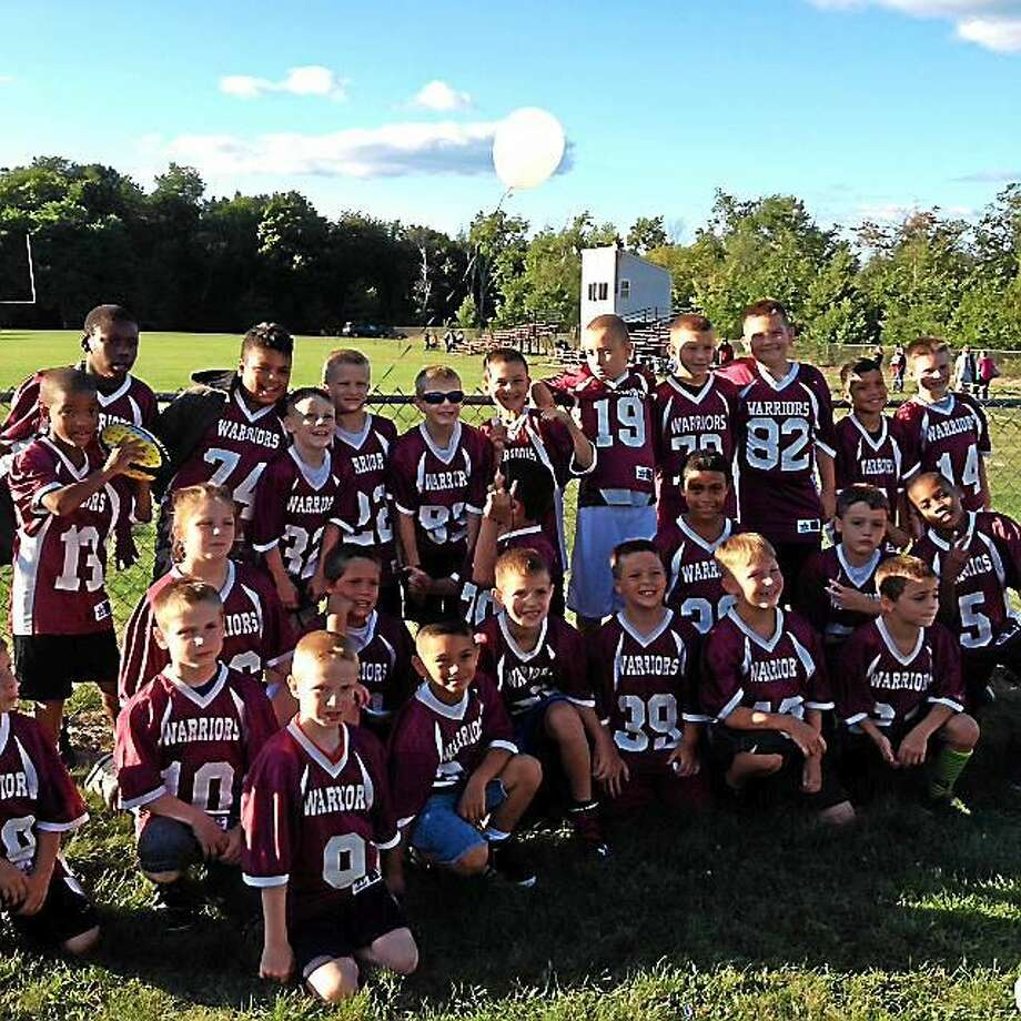 The Torrington Warriors Football and Cheer program held its annual pep rally Friday night. Photo: Amanda Webster — The Register Citizen