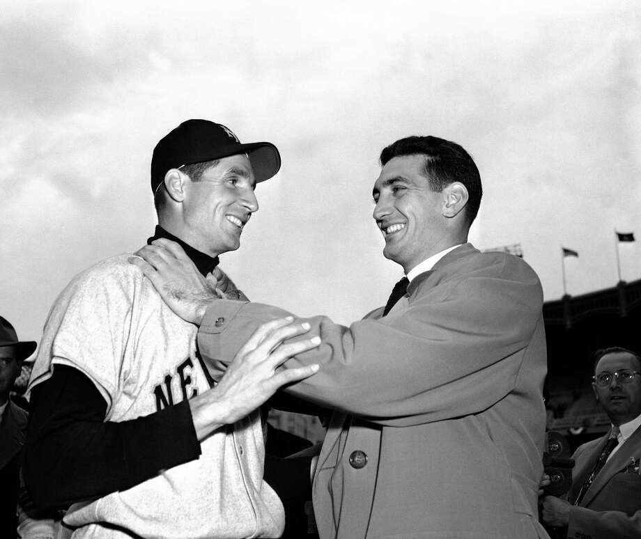 """In this file photo, Bobby Thomson, left, of the New York Giants, and Ralph Branca of the Brooklyn Dodgers, engage in horse play before a World Series game at Yankee Stadium in New York. Branca, the Brooklyn Dodgers pitcher who gave up the home run dubbed the """"Shot Heard 'Round the World,"""" has died at the age of 90. His son-in-law Bobby Valentine, a former major league manager, says Branca died Wednesday  at a nursing home in Rye, New York. Photo: File — The Associated Press  / AP1951"""