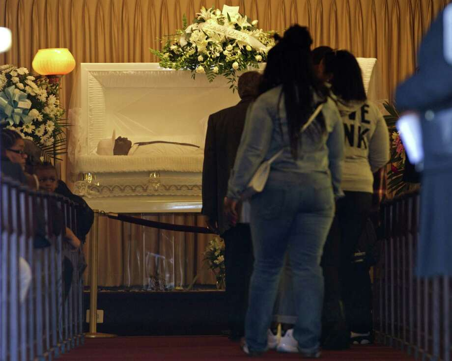 The body of Freddie Gray lies inside his casket at Vaughn Greene Funeral Home, during his wake Sunday, April 26, 2015 in Baltimore. Gray died from spinal injuries about a week after he was arrested and transported in a police van. Photo: AP Photo/Jose Luis Magana  / FR159526 AP