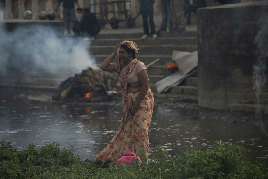 A woman weeps during the cremation of an earthquake victim at the Pashupatinath temple, on the banks of Bagmati river, in Kathmandu, Nepal on April 26, 2015. Photo: AP Photo/Bernat Armangue  / AP