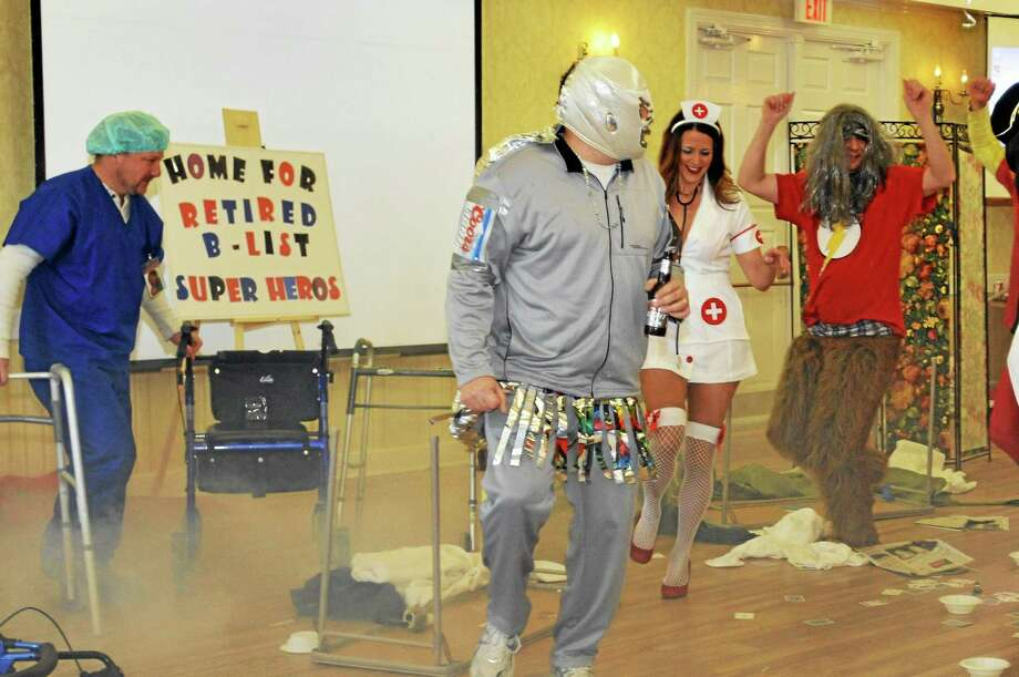 """Performers act during the """"Home for retired B list superheroes"""" sketch in a prior Possum Queen contest in Litchfield. Photo: Register Citizen File Photo"""