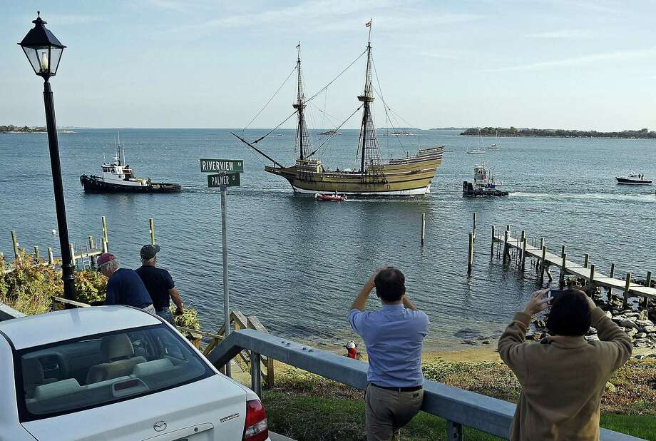 In this Nov. 2, 2016 photo, spectators photograph the Mayflower II in Groton as it enters the Mystic River en route to Mystic Seaport. The 1957 replica of the vessel that brought the Pilgrims to the new world in 1620, is will undergo a complete overhaul in time for festivities in 2020 that will mark the 400th anniversary of the Pilgrim landing. Photo: Sean D. Elliot — The Day Via AP / 2016 The Day Publishing Company