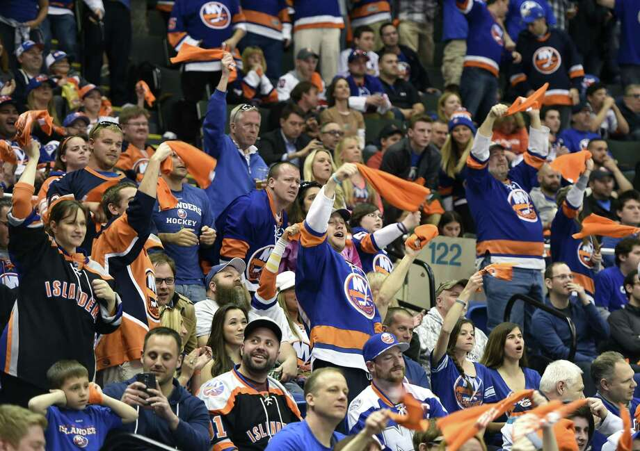 New York Islanders fans cheer on their team against the Washington Capitals during the third period of Game 6 Saturday at Nassau Coliseum in Uniondale, N.Y. Photo: Kathy Kmonicek — The Associated Press  / FR170189 AP