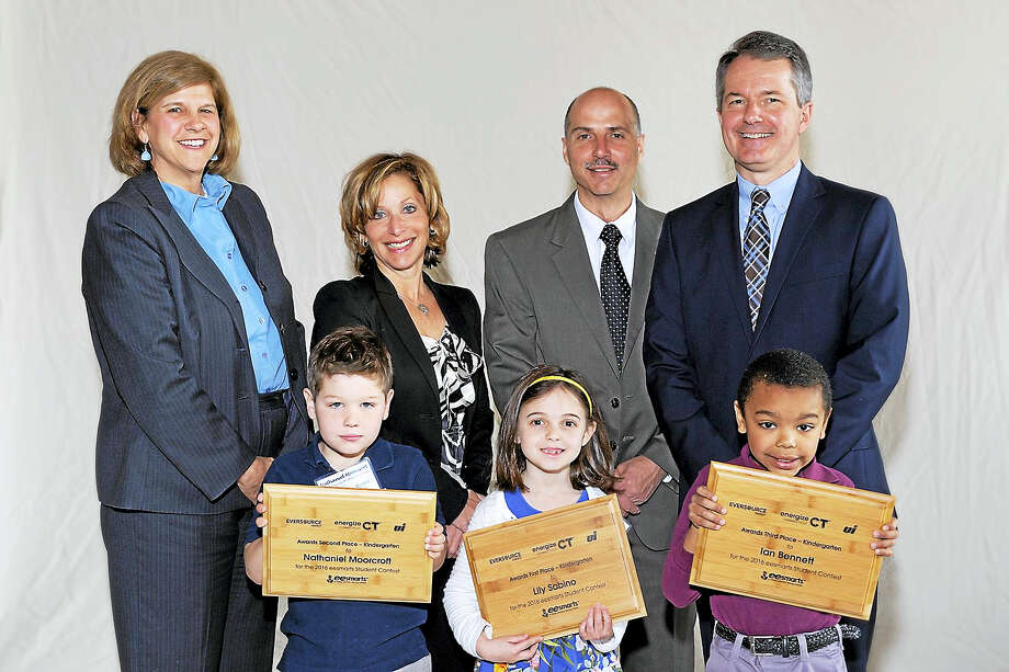 Kindergartener Ian Bennett wins 3rd place at the 12th annual eesmarts student contest. He is pictured with other category winners, DEEP's Tracy Babbage, Deputy Mayor Shari Cantor, Stephen Bruno with Eversource and Patrick McDonnell with United Illuminating Company. Photo: Journal Register Co.