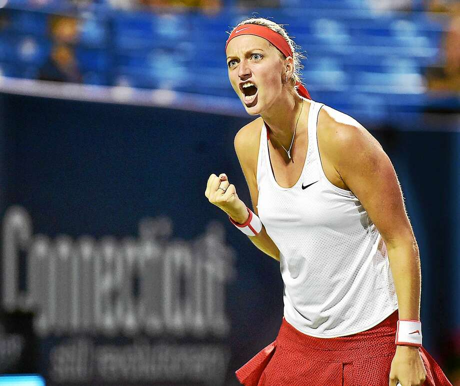 Petra Kvitova celebrates late in her 7-5, 6-1 win over Caroline Wozniacki on Friday night in the semifinals of the Connecticut Open. Photo: Catherine Avalone — Register  / New Haven RegisterThe Middletown Press