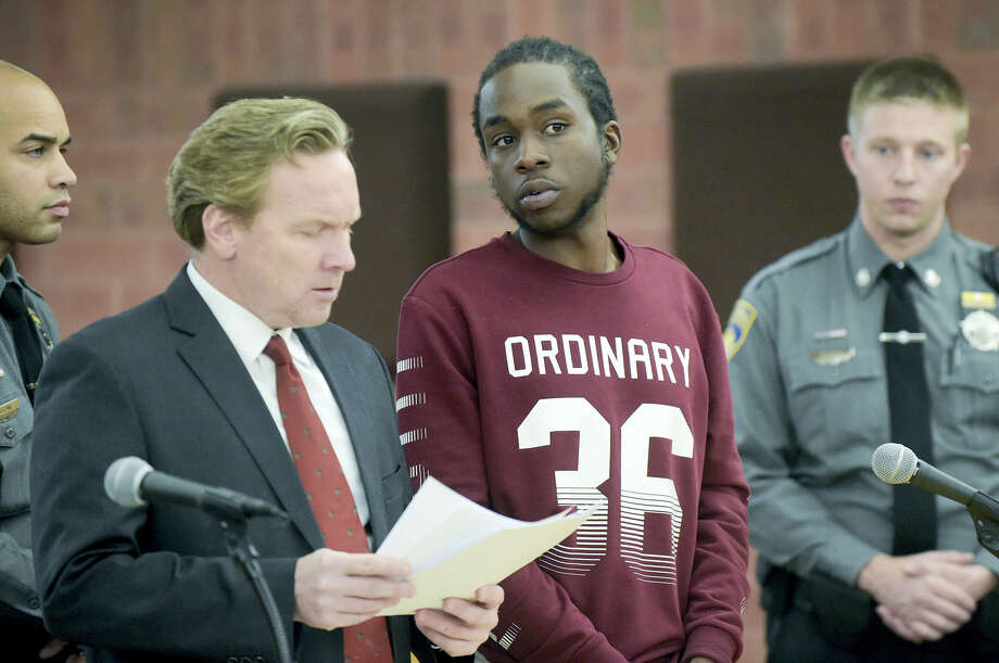 Kwanze Fluker, 22, of Bloomfield, joined by public defender Sean Crowshaw, left, is arraigned in Hartford Superior Court on Wednesday afternoon, Nov. 23, 2016, in Hartford. Fuker and 17-year-old Hartford male, were arrested following a Nov. 6, drive-by shooting that left a 10-year-old girl with a gunshot wound to the face in Hartford earlier this month. Photo: Patrick Raycraft — Hartford Courant Via AP / Hartford Courant