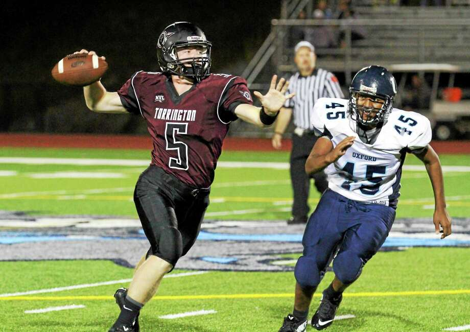 Senior quarterback Connor Finn (5) gets two prime receivers back from last year's injuries. Photo: Marianne Killackey — For The Register Citizen  / 2014