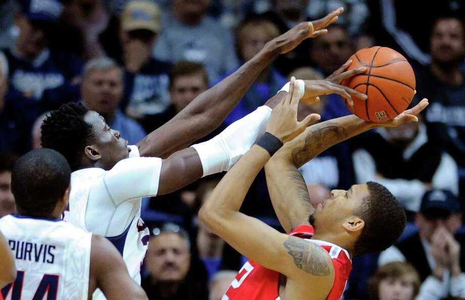 Fred Beckham — The Associated Press Ohio State's Marc Loving's (2) shot is blocked by Connecticut's Amida Brimah (35) as Rodney Purvis looks on during the first half. Brimah will be out 6 to 8 weeks with a fractured finger. Photo: AP / FR153656 AP