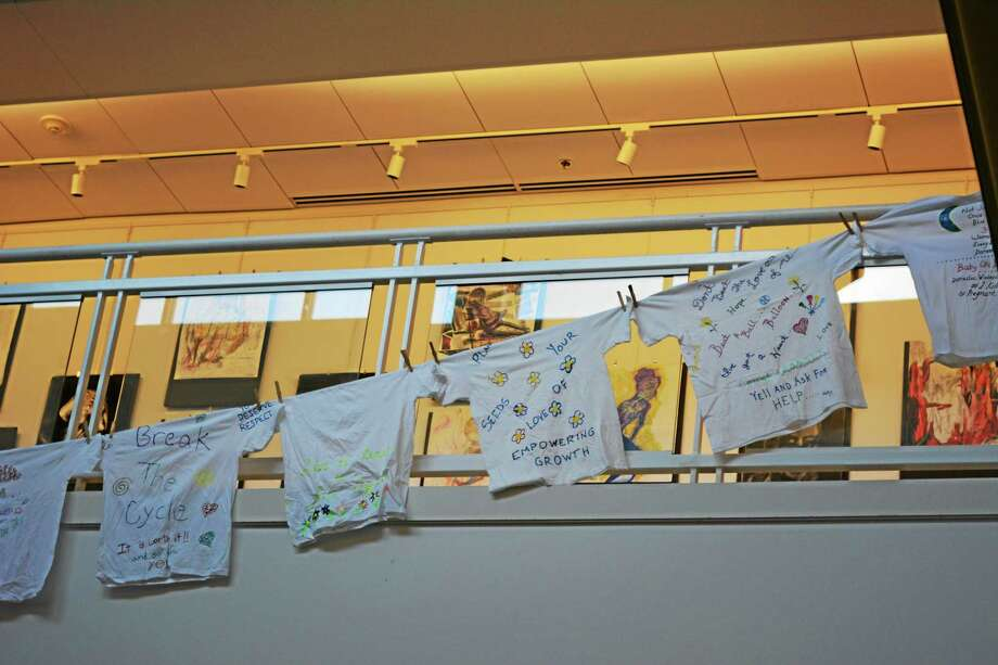 T-shirts promoting messages of support for sexual violence victims were strung along the interior of the Arts and Sciences building at NCCC. Photo: Ben Lambert — The Register Citizen