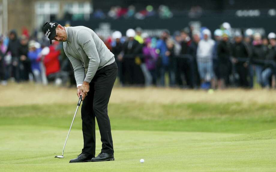 Henrik Stenson puts on the first green during the third round of the British Open on Saturday. Photo: Ben Curtis — The Associated Press  / Copyright 2016 The Associated Press. All rights reserved. This material may not be published, broadcast, rewritten or redistribu