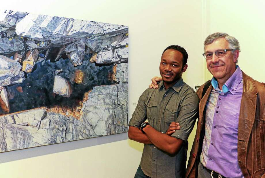 Budding artist and 2013 Torrington High School graduate Phillip Tanner with his former teacher Victor Leger. Photo: Photo By John Fitts