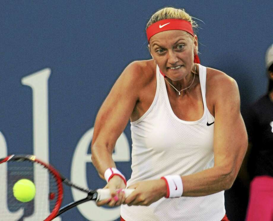Defending champion Petra Kvitova returns a shot to Agnieszka Radwanska on Thursday at the Connecticut Open in New Haven. Photo: Bob Child — For The Register