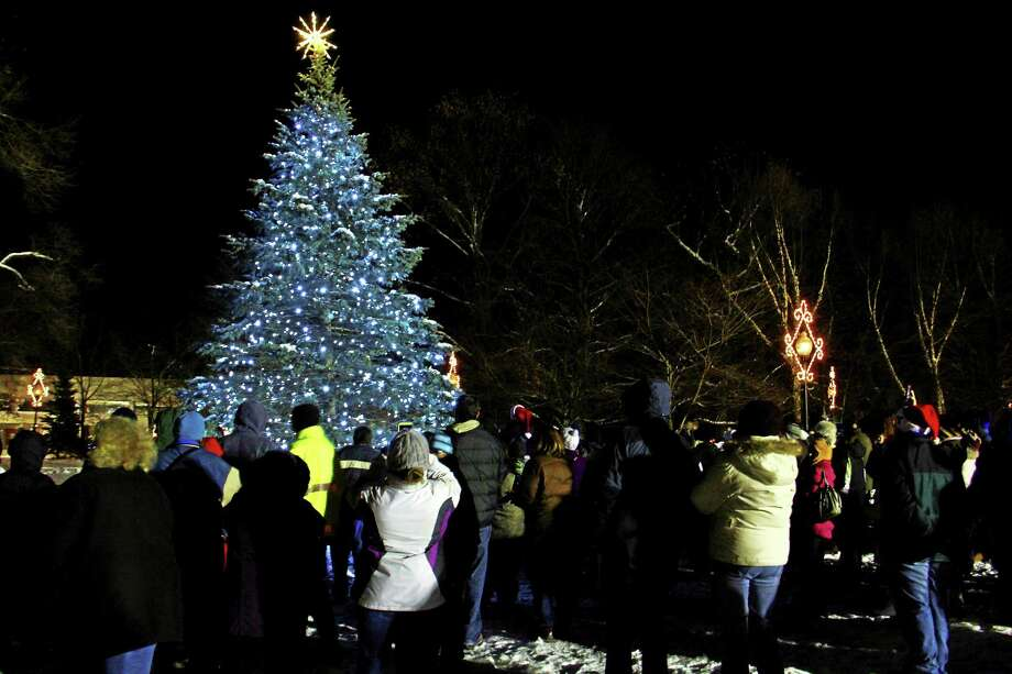 The Coe Memorial Park tree glows blue after a treelighting. Photo: Register Citizen File Photo