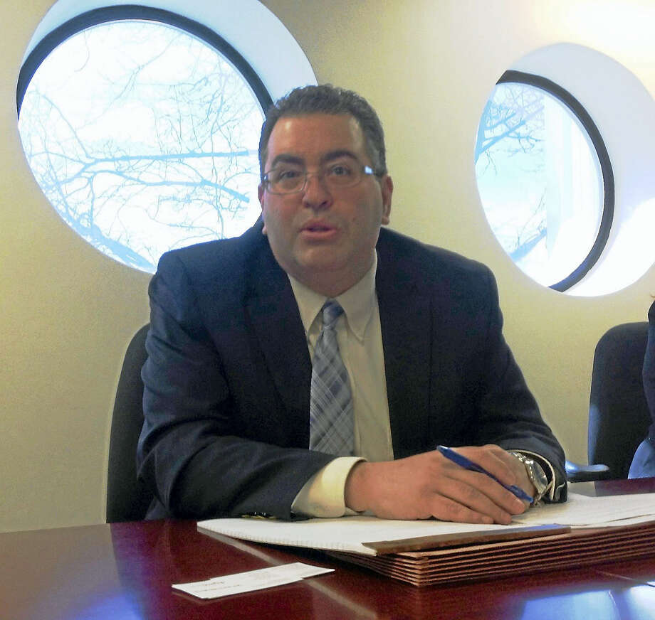 Michael J. Brandi, executive director and general counsel of the Connecticut State Elections Enforcement Commission, makes a point while speaking to the Register Editorial Board. Photo: Journal Register Co.