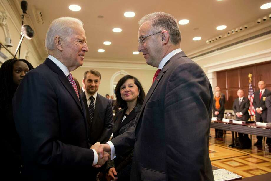 Vice President Joe Biden shakes hands with Rotterdam Mayor Ahmed Aboutaleb as the vice president arrives to speaks at a roundtable, part of the White House Summit on Countering Violent Extremism on Feb. 17, 2015, in the Eisenhower Executive Office Building on the White House Complex in Washington. Photo: AP Photo/Jacquelyn Martin  / AP