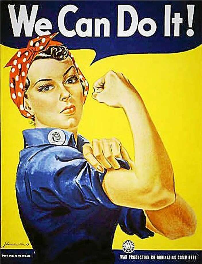 """Rosie the Riveter"" dressed in overalls and bandanna was introduced as a symbol of patriotic womanhood in the 1940's.  Rose Will Monroe played  ""Rosie the Riveter,"" the nation's poster girl for women joining the work force during World War II.  Monroe was working as a riveter building B-29 and B-24 military airplanes at the Willow Run Aircraft Factory in Ypsilanti, Mich., when she was asked to star in a promotional film about the war effort.  (AP Photo) Photo: AP / NATIONAL ARCHIVES"