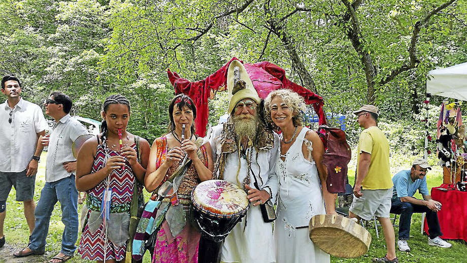 """""""Faerie musicians"""" Mila Gonzalez, 11, of Waterbury; Victoria Muñoz of Waterbury; Billy Fischer of Woodbury; and Abigail Rabinowitz of Bethany led the """"Faerie Parade"""" at the fifth annual Faerie Fest at the Flanders Nature Center's Sugar House and Trail House grounds off Church Street in Woodbury on Saturday afternoon. Photo: N.F. AMBERY — THE REGISTER CITIZEN"""