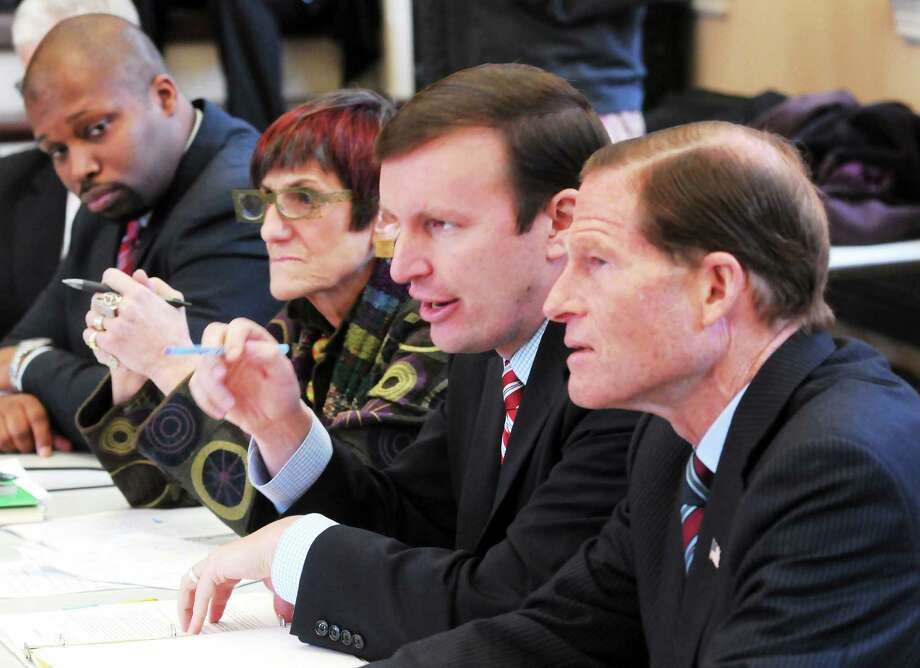 New Haven Register file photo A round table discussion was held by members of the Connecticut Congressional delegation at The Grove in New Haven in this January 2014 file photo. From left: State Rep. Gary Holder-Winfield, U.S. Congresswoman Rosa DeLauro, and U.S. Sens. Chris Murphy and Richard Blumenthal. Photo: Journal Register Co. / Mara Lavitt