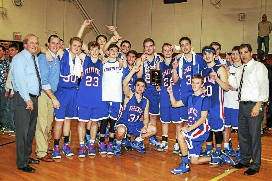 The Nonnewaug boys basketball celebrates its Berkshire League boys basketball championship with plaque in hand. Photo: Photo By Marianne Killackey  / 2015