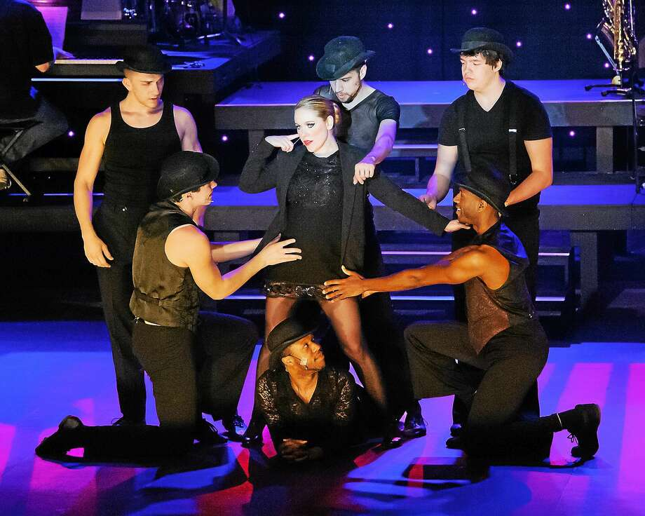 """Photos curtesy of Lisa Cherie Photography Emily Diedrich, center, plays the role of Roxie Hart with her male ensemble in Landmark Community Theatre's production of """"Chicago"""" at the Thomaston Opera House. Photo: Journal Register Co."""