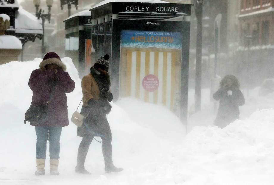 In this Feb. 15, 2015 photo, pedestrians brace against blowing snow in Copley Square in Boston. Photo: AP Photo/Michael Dwyer, File  / AP