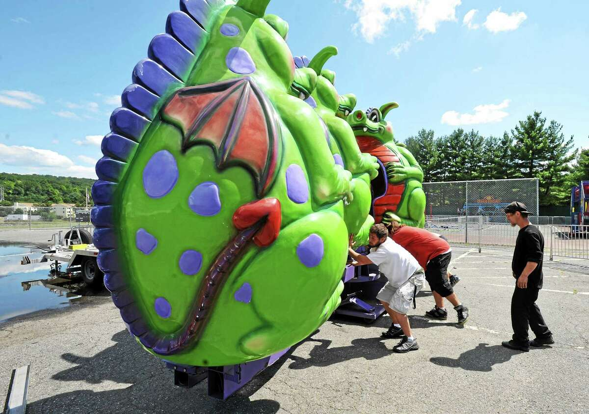 Employees with Goshen-based R.W. Commerford and sons prepare to set up the Dizzy Drago ride for Fuse Fest. Visible are Eric Rodriguez (in white) Bob Moulthrop and Jesse Dvorovy (in black).