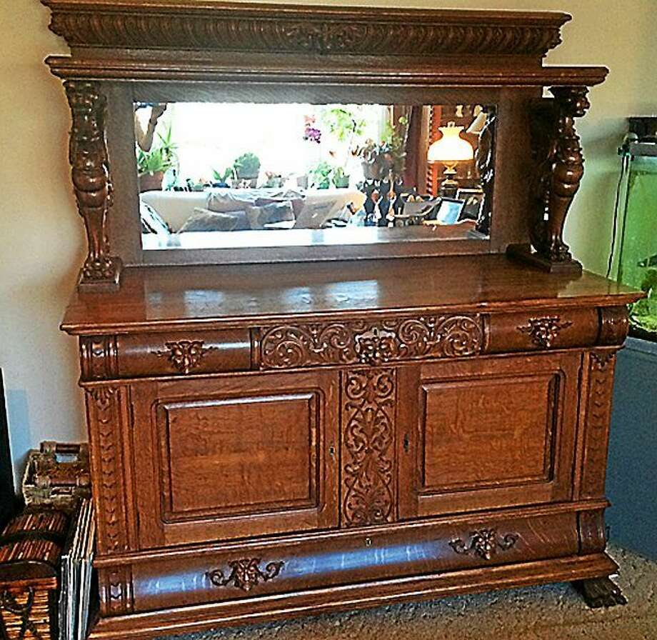 Images courtesy of Tim's Inc. Auctions Oak Griffin Carved Side Board, attributed to R.J. Horner Photo: Journal Register Co.