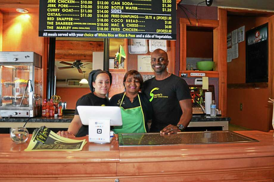 """From left, Carmen Francis, Sharon Sherrier and Byron Francis behind the counter at Sherrier's """"Sweet"""" Jamaican Cuisine, 325 N. Elm St., Torrington. Photo: Amanda Webster — The Register Citizen"""