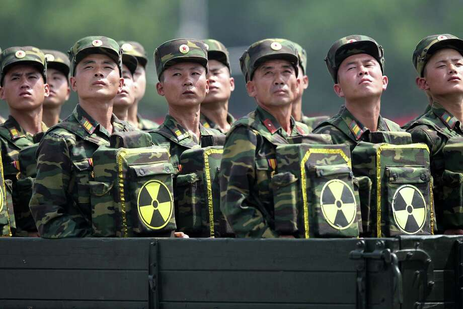 In this July 27, 2013, file photo, North Korean soldiers turn and look towards leader Kim Jong Un as they carry packs marked with the nuclear symbol as they parade during a ceremony marking the 60th anniversary of the Korean War armistice in Pyongyang, North Korea. As North Korea awaits the United Nationsí response to its purported first H-bomb test, Washington is believed to be floating measures that could cause it some serious problems. They range from a ban on selling the North oil or buying its minerals to excluding banks doing business with it from accessing the dollar-based economy or even barring its flagship airline from entering other countriesí airspace. Photo: AP Photo/Wong Maye-E, File   / AP