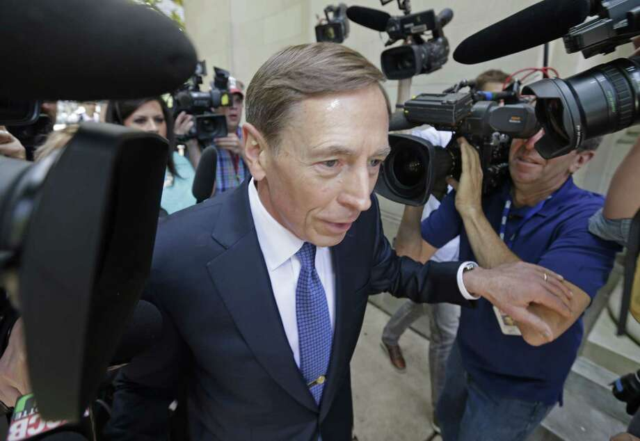 Former CIA director David Petraeus, whose career was destroyed by an extramarital affair with his biographer, arrives for sentencing at the federal courthouse in Charlotte, N.C., Thursday, April 23, 2015. Petraeus is expected to plead guilty to sharing top government secrets with his biographer. Photo: (AP Photo/Bob Leverone) / FR170480 AP