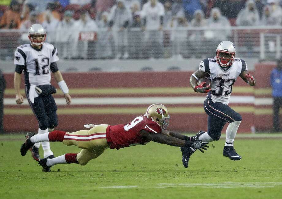 Patriots running back Dion Lewis (33) runs against the 49ers on Sunday. Photo: Marcio Jose Sanchez — The Associated Press  / Copyright 2016 The Associated Press. All rights reserved.