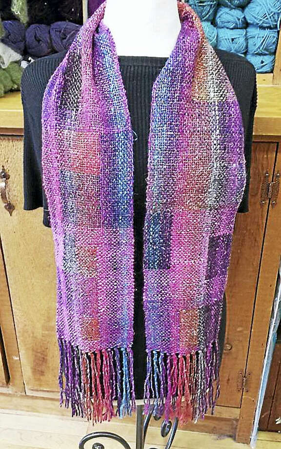Photo by Ginger Balch A scarf made by stained glass weaving, which requires the use of multicolored yarns to create the look of blocks within the weaving. This technique allows the weaver an almost painterly approch to their project. Photo: Journal Register Co.