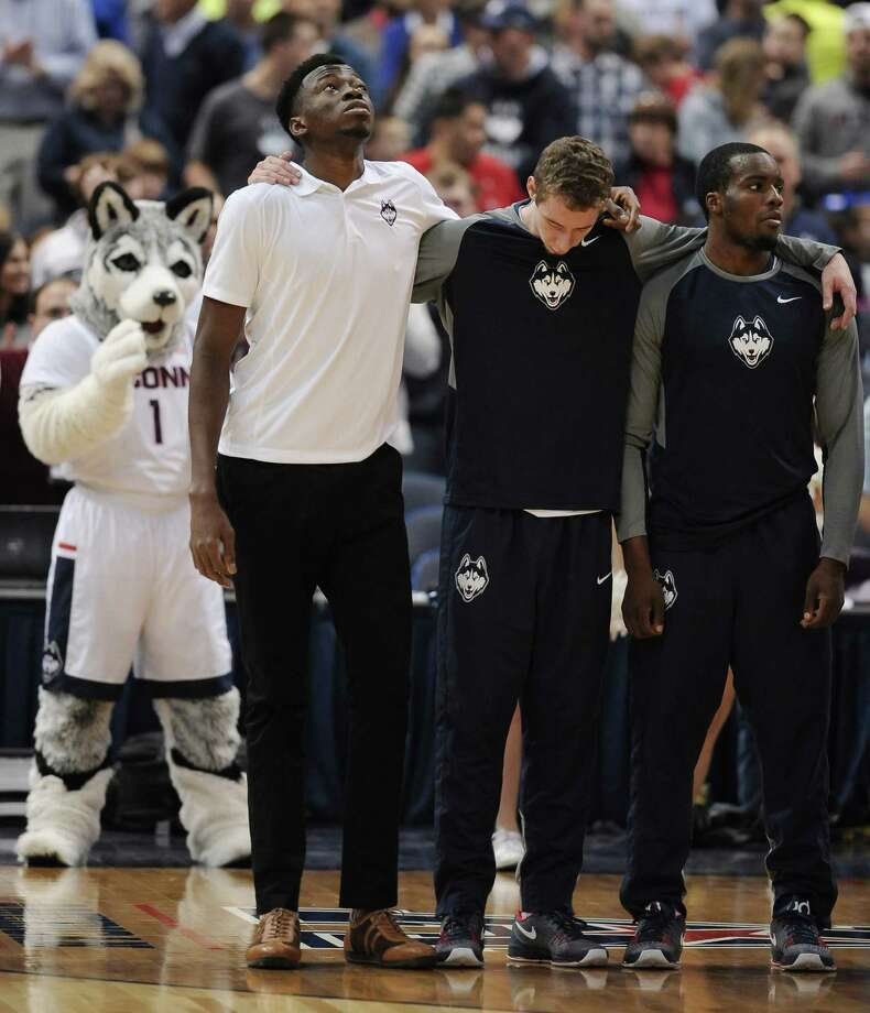 UConn's Amida Brimah, left, looks up during the playing of the national anthem before Sunday's game in Hartford. Photo: Jessica Hill — The Associated Press  / FR125654 AP