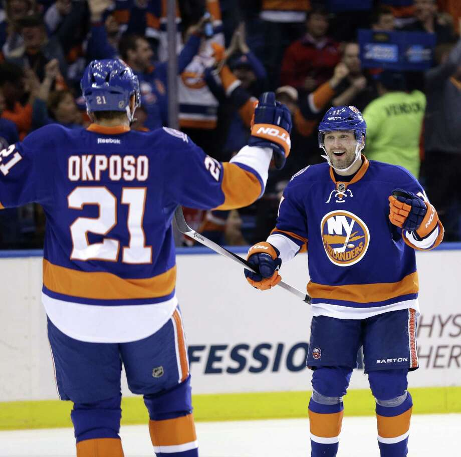 The New York Islanders' Lubomir Visnovsky celebrates with Kyle Okposo after Okposo scored during Game 3 Sunday against the Washington Capitals in Uniondale, New York. Photo: Seth Wenig — The Associated Press  / AP