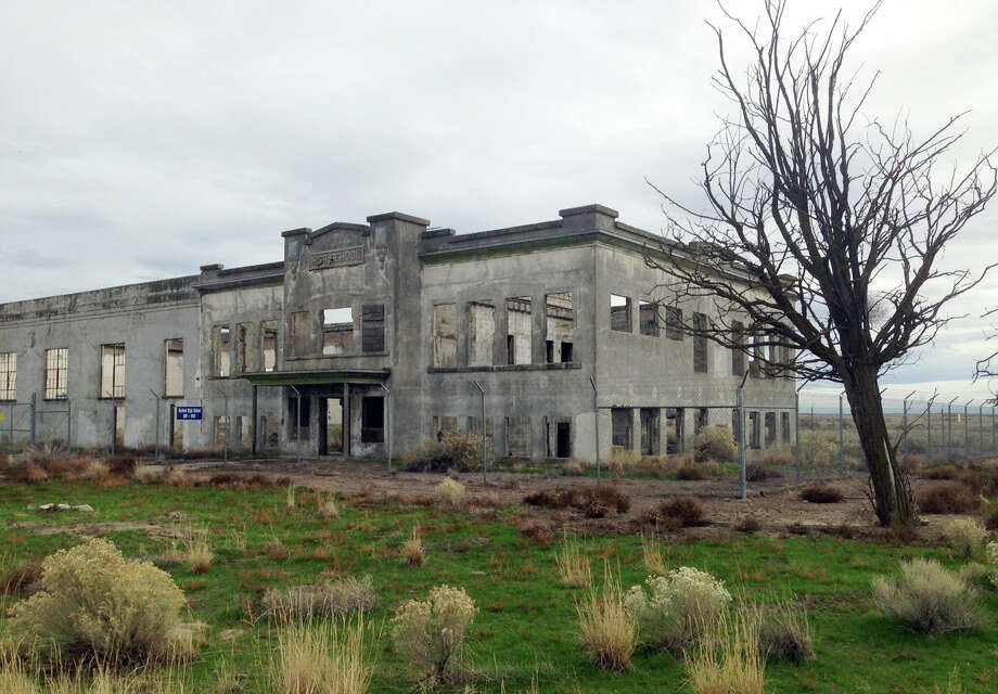 In this undated photo provided by the U.S. Department of Energy, the ruins of the old Hanford High School are shown near Richland, Wash. The towns of Hanford and White Bluffs were evacuated to make room for the Hanford Nuclear Reservation, which made the plutonium for the atomic bomb dropped on Nagasaki, Japan, and the ruins of the high school and other buildings are now part of the nation's newest national park, called the Manhattan Project National Historic Park. Photo: Courtesy Of The U.S. Department Of Energy Via AP  / U.S. Department of Energy