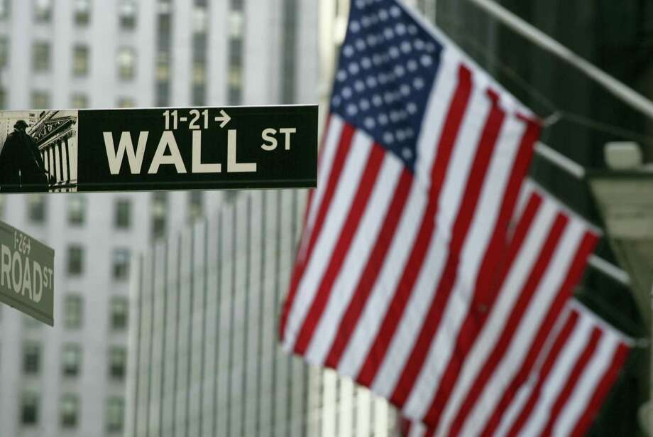 FILE - In this Sept. 17, 2008 file photo, a Wall Street sign is shown in New York.  Stocks are rising modestly in early morning trading Friday, July 15, 2016 as the market extends a winning streak into a sixth day. Photo: THE ASSOCIATED PRESS / AP