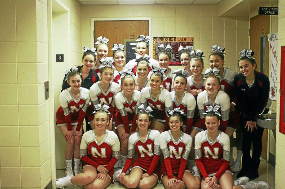 Northwestern High School's cheerleaders took home a trophy from a mega-meet at St. Joseph College February 20. Christina Pollutro took first place in the top gun tumbling competition. Earlier, Gina Pedrolini, Kira Consic and Leann Grogan were named Class M All-State. Photo: Submitted Photo