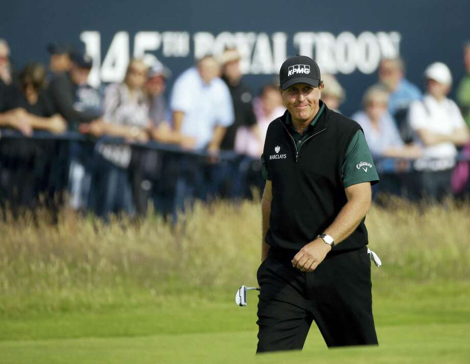 Phil Mickelson of the United States smiles as he walks onto the 18th green during the first round of the British Open Golf Championship at the Royal Troon Golf Club in Troon, Scotland, Thursday, July 14, 2016. (AP Photo/Matt Dunham) Photo: AP / Copyright 2016 The Associated Press. All rights reserved. This material may not be published, broadcast, rewritten or redistribu