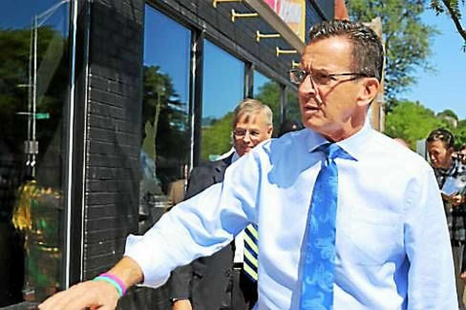 Gov. Dannel P. Malloy walks along Main Street in New Britain to tout CTfastrak. Photo: Christine Stuart Photo
