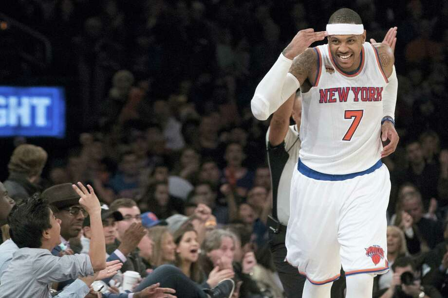 Knicks forward Carmelo Anthony reacts after scoring a 3-pointer on Sunday. Photo: Mary Altaffer — The Associated Press  / Copyright 2016 The Associated Press. All rights reserved.