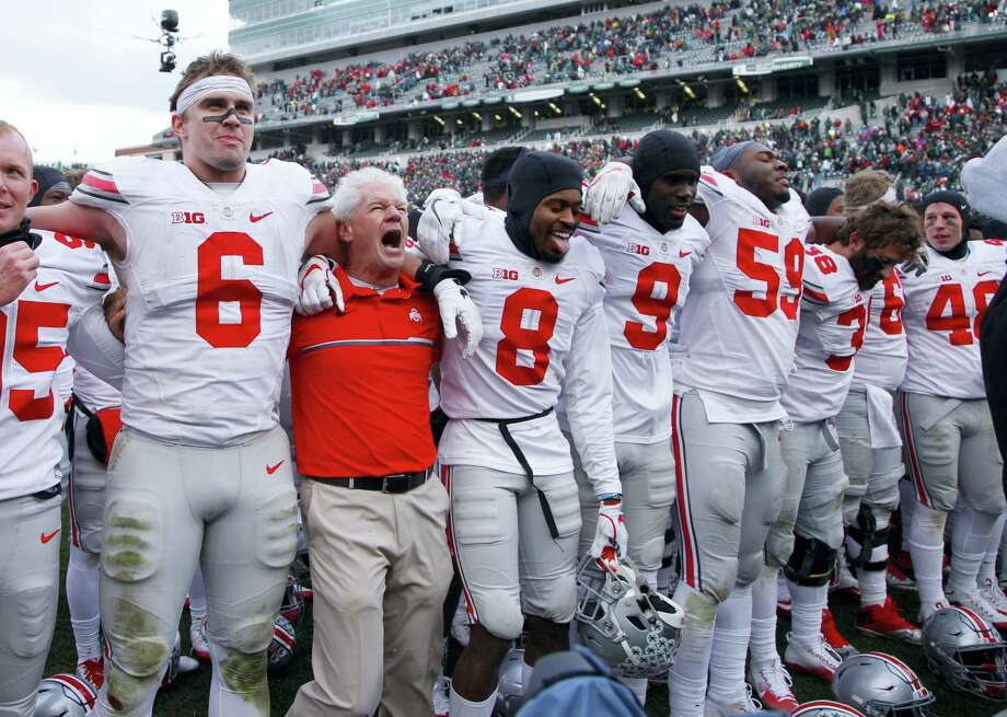 Ohio State players celebrate following a 17-16 win over Michigan State on Saturday. Photo: Al Goldis — The Associated Press  / FR11125 AP