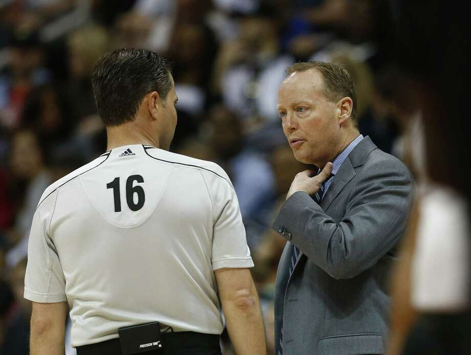 Hawks head coach Mike Budenholzer talks with referee David Guthrie during an April 13 game against the New York Knicks in Atlanta. Photo: John Bazemore — The Associated Press  / AP