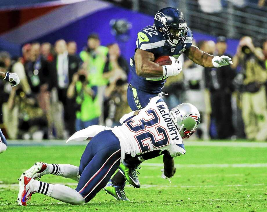 New England Patriots free safety Devin McCourty tackles Seattle Seahawks running back Robert Turbin during Super Bowl XLIX. Photo: Mark Humphrey — The Associated Press File Photo  / AP