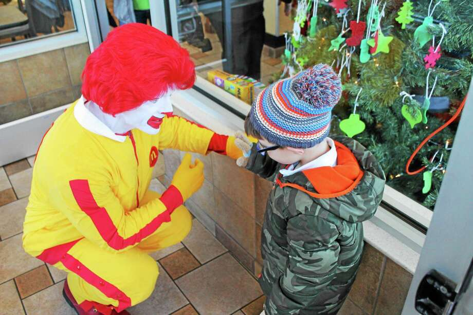 A McDonald's fundraiser wouldn't be complete without Ronald McDonald and he was on hand Saturday morning to welcome guests, talk to kids and celebrate the success of the ornament fundraiser. Photo: John Nestor — Register Citizen